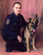 Photo of Officer Brian Delos-Santos and his K9
